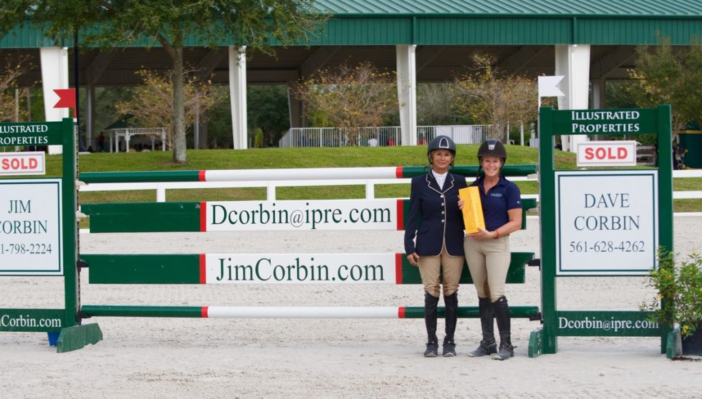 Debbie Stephens being presented with the EQUO Stylish Rider Award by Nona Garson (Photo courtesy of Equinium Sports Marketing)